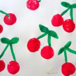 Korkendruckbild mit Kirschen
